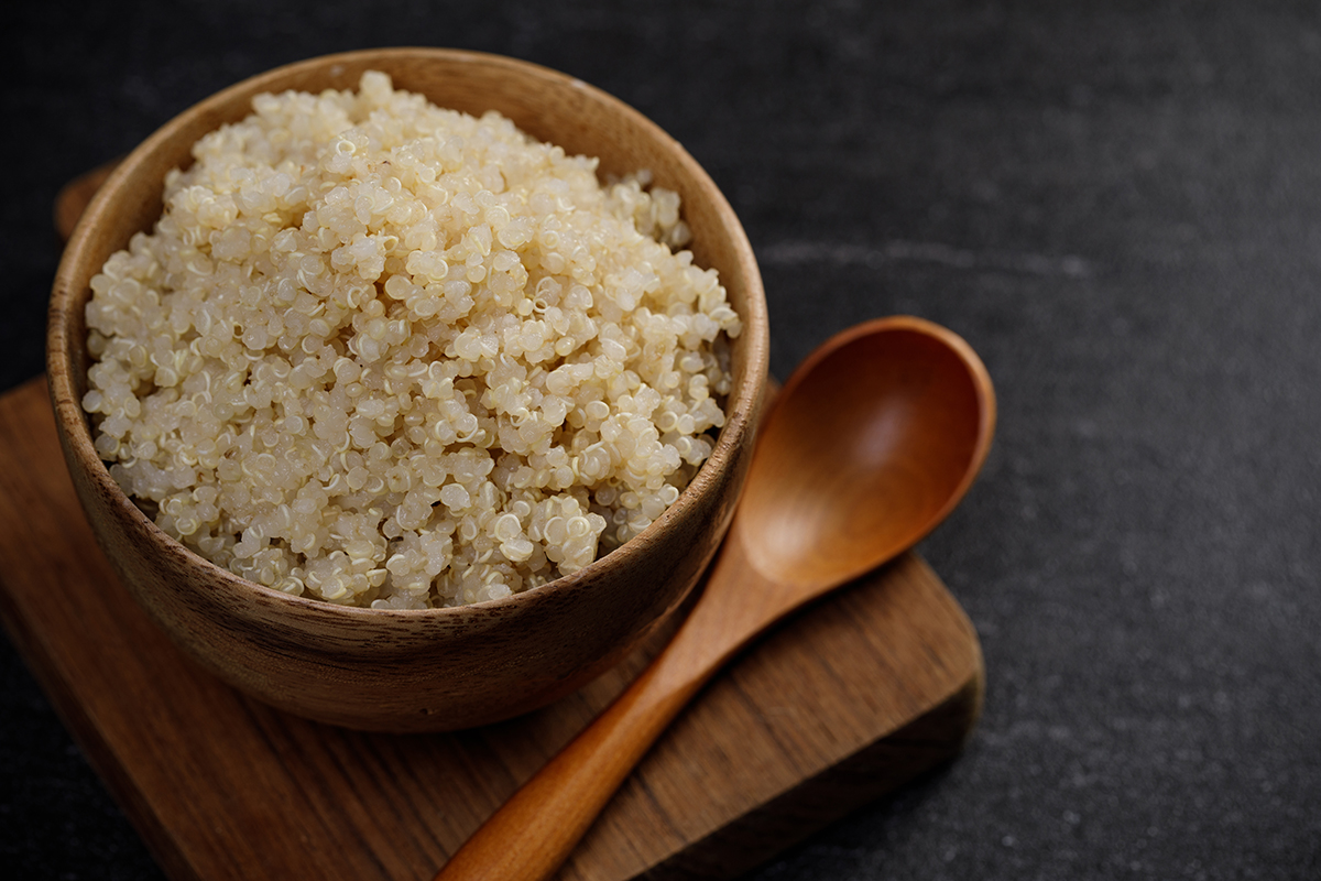 Healthy quinoa in the wooden bowl, Healthy food habits and conce